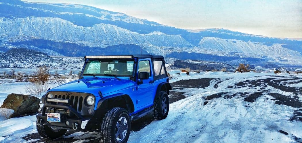jeep color blue with soft top in snow