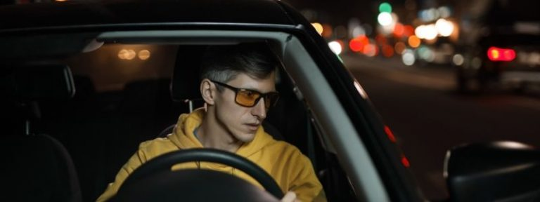 man driving at night with glasses
